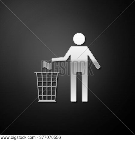 Silver Man Throwing Trash Into Dust Bin Icon Isolated On Black Background. Recycle Symbol. Long Shad
