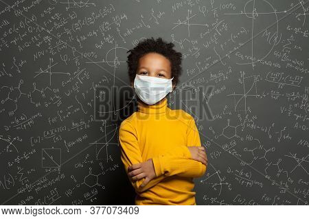 Successful Black Child Boy Student In Protective Face Mask On Black Chalkboard Background