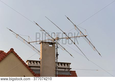 Tv Antenna On Roof Of Home. Technology Of Broadcast Television And Radio On Rooftop. Signal Receiver