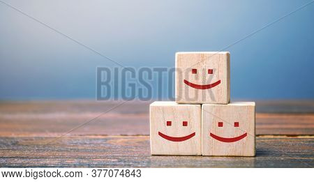 Smiling Faces On Wooden Blocks. Feedback, Critic's Assessment, Service Rating, Ranking, Customer Rev