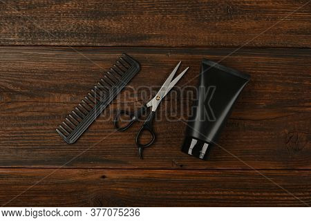 Close Up Flat Lay Of Men Grooming Tools And Accessories On Barber Shop Wooden Desk, Elevated Top Vie