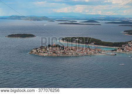 Town Of Primosten Peninsula Seen From A Nearby Hill. Blue Bright Day, Adriatic Sea Surrounding The S