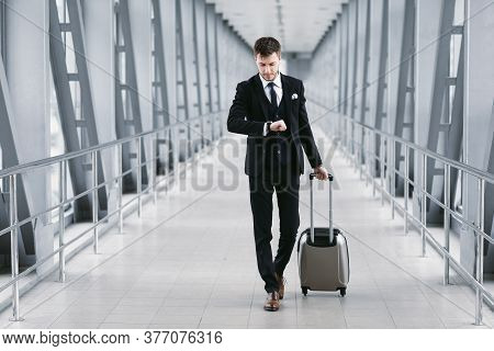 Boarding Time. Confident Man Checking Time On Watch, Walking With Suitcase In Airport, Going To Depa