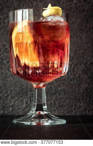 Glass Of Americano Cocktail Garnished With Orange Slice And Lemon Zest