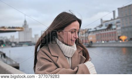Sad Girl Freezes On The Street Moscow. Person Walking Along The Promenade. Mysterious Girl Walking B