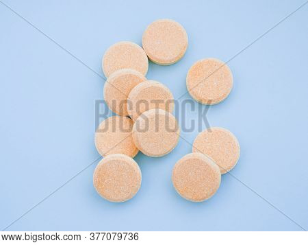 Soluble Effervescent Vitamins With Orange Flavour On Blue Background. Healthcare And Medical. Close-