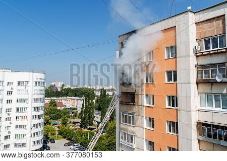Fire On The Balcony Of A Multi-storey Building, Black Clouds Of Smoke, Apartment Smoke, Extinguishin