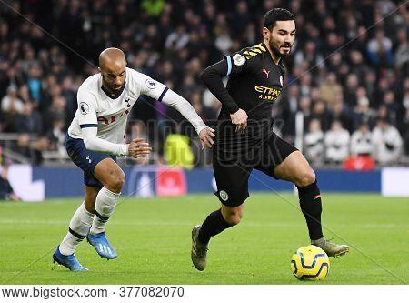 London, England - February 2, 2020: Lucas Moura Of Tottenham And Ilkay Gundogan Of City Pictured Dur