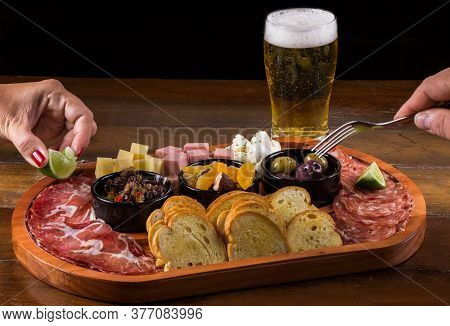 People Eating Cheese Board And Appetizers. Appetizer Board