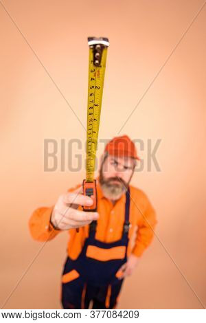 Measuring Device. Engineer Use Measuring Tape. Builder With Measure Tape. Selective Focus. Construct