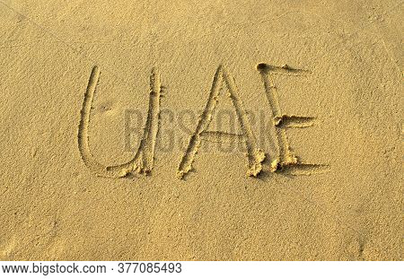 Uae Word Abbreviation On Beach Sand. Uae Capital Letters Are Written On A Sand. Handwriting