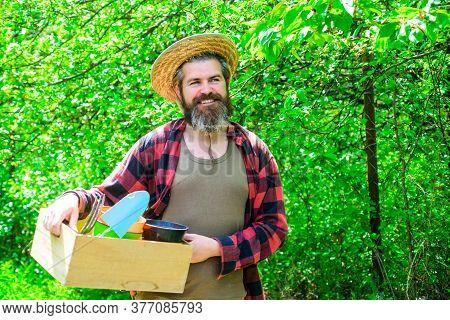 Happy Bearded Man In Garden. Plants. Garden Tools. Gardening. Eco-farm. Work In Garden. Bearded Man