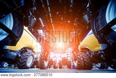 Modern Agricultural Machinery And Equipment. Yellow Agricultural Harvester.