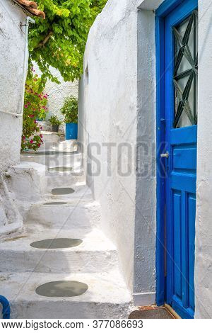 Old Blue Door On Narrow Street In Anafiotika, Plaka District, Athens, Greece. Plaka Is Tourist Attra