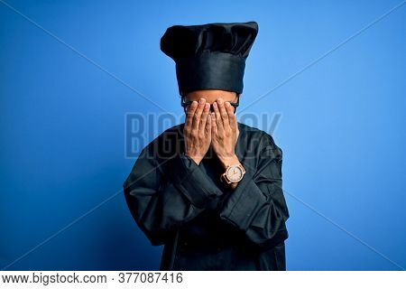 Young african american chef woman wearing cooker uniform and hat over blue background rubbing eyes for fatigue and headache, sleepy and tired expression. Vision problem