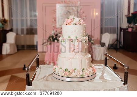 Three-tier Wedding Cake Decorated With Creamy Roses