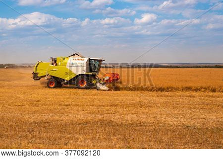 Rostov Region, Russia-01.07.2020: Harvesting Wheat In The Field On A Summer Day, Harvesters Harveste