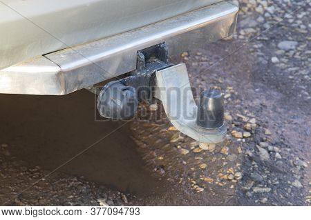 Tow Bar With Socket Installed On A Passenger Car. A Car Prepared For Cargo Transportation.