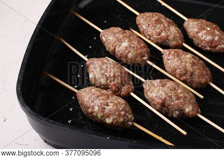 Kofta Shashlik On Wooden Skewers Is Cooked In A Grill Pan, Closeup