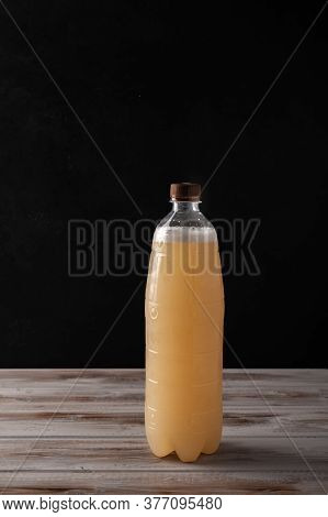 White Plastic Bottle Of Beer Or Light Rye Kvass On Wooden Background With Copy Space For Text. Rusti