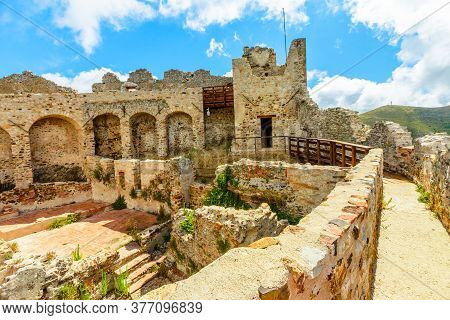 View Of Ruins From City Walls Of Castello Del Volterraio Or Volterraio Castle, The Oldest Fortress O