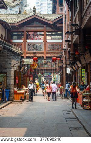 CHONGQING, CHINA - MAY 30, 2014: Shoppers at historic Hongyadong.