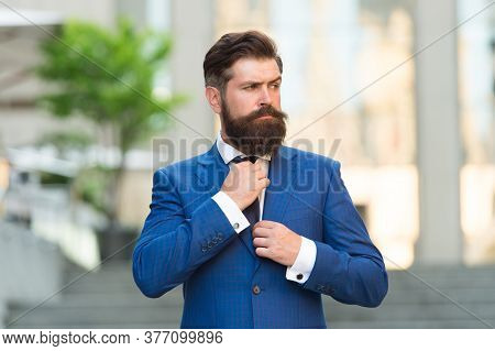 On The Way To Office. Modern Life Fashion. Businessman In Blue Suit Tying Tie. Man Wear Wedding Jack