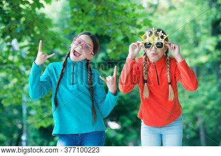 All The Fun Of Primary School Prom. Cool Look Of Prom Girls. Happy Children Wear Fancy Glasses. Fash