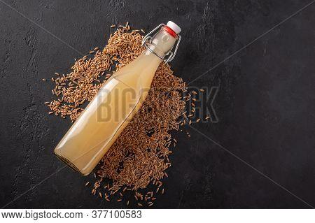 Top View Homemade Tradishional Russian Light Rye Kvass In Bottle On Dark Wooden Background. Wonderfu