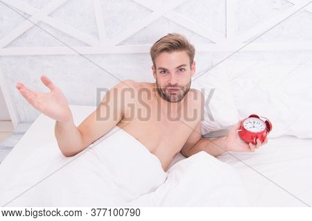 Isnt It Sexy. Sexy Man Hold Alarm Clock. Bachelor Lying In Bed. Handsome Guy With Sexy Bare Chest. G