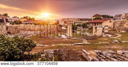 Landscape Of Athens At Sunset, Scenic Sunny View Of Old Library Of Hadrian, Greece. This Place Is La