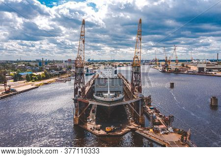 Aerial View Of The City's Waterfront And Port Infrastructure. The Average Dry Floating Dock. Big Tra