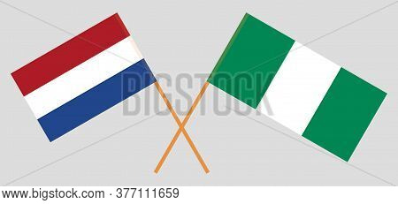 Crossed Flags Of Nigeria And Netherlands. Official Colors. Correct Proportion. Vector Illustration