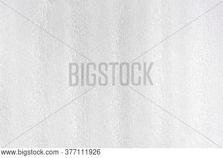 Foam White Plastic Texture. Styrofoam Abstract Grey Surface With Grain Structure. Synthetic Material