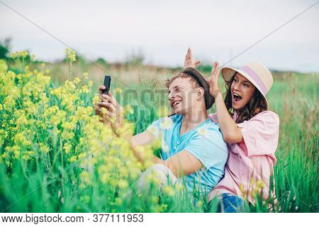 Young Couple In Love Outdoor. Stunning Sensual Outdoor Portrait Of Young Stylish Fashion Couple Posi