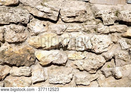 View Of A Wall Of Stones Of Irregular Shapes Backgrounds Textures For Graphic Design Wallpapers Wall
