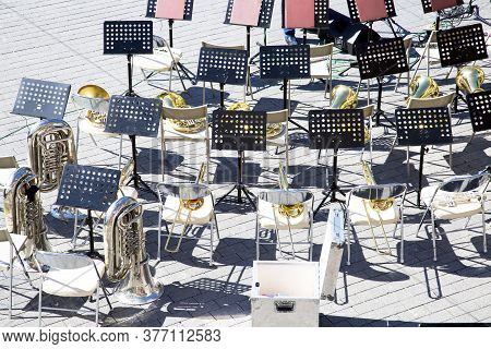 Top View Of The Chairs Music Stands Brass Band Instruments. Preparation Of The Festival Of Military