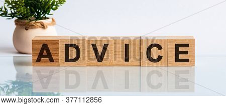 Advice Word Written On Wood Block. Advice Text On Wooden Table For Your Desing, Front View Concept.