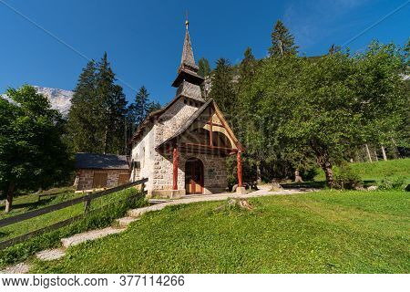 Small Church Surrounded By Nature Under The Seekofel Mountains Next To Lake Braies, Italian Landscap