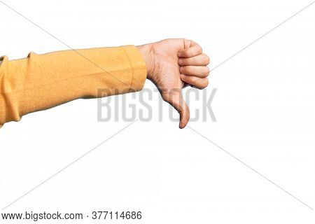 Hand of caucasian young man showing fingers over isolated white background doing thumbs down rejection gesture, disapproval dislike and negative sign