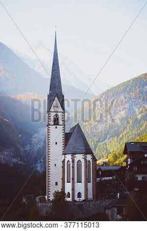 Famous Church At The Heiligenblut Town At The Austrian Alpine Grossglockner Road  At The Autumn Day
