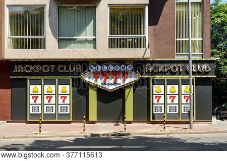 Varna, Bulgaria, July 16, 2020. The Front View Of A Jackpot Club Entrance. Signage Boards On Front A