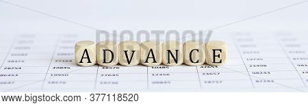 Text Advance On A Wooden Cube Blocks