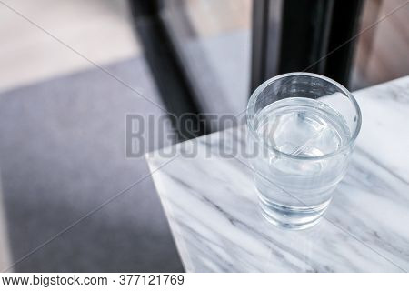 Glass Of Purified Fresh Drink Water On Marble Table In Cafe Or Coffee Shop.concept: Nature, Purifica