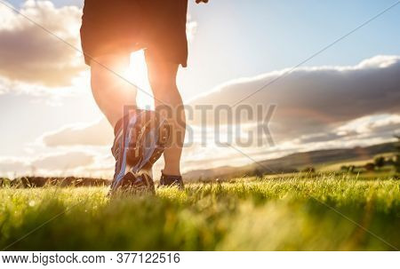 Outdoor cross-country running in early sunrise concept for exercising, fitness and healthy lifestyle