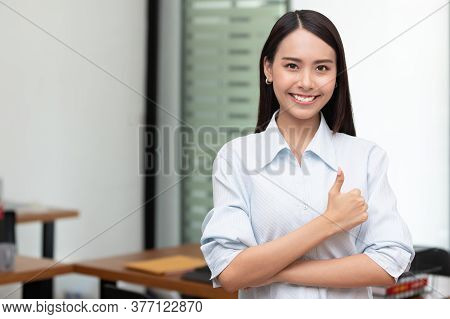 Confident Business Asian Woman Stand And Cross Arm In The Office.