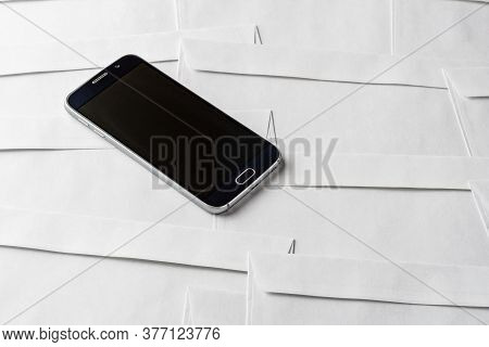 Angle View Of Smartphone Is On Paper Envelopes Background