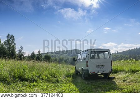 Russia, Mansky District, July 13, 2020: Sky, Clouds, Hills And Mountains. Travel By Car Gaz Sobol An