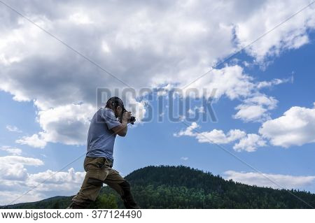 A Male Photographer Shoots And Photographs The Sky And Mountains. Beautiful View