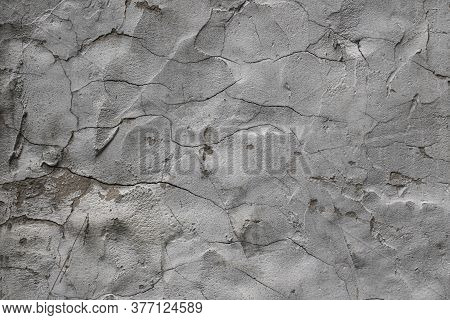 Texture-old Gray Plaster With Cracks Close-up Texture-old Gray Plaster With Cracks Close-up On A Dar